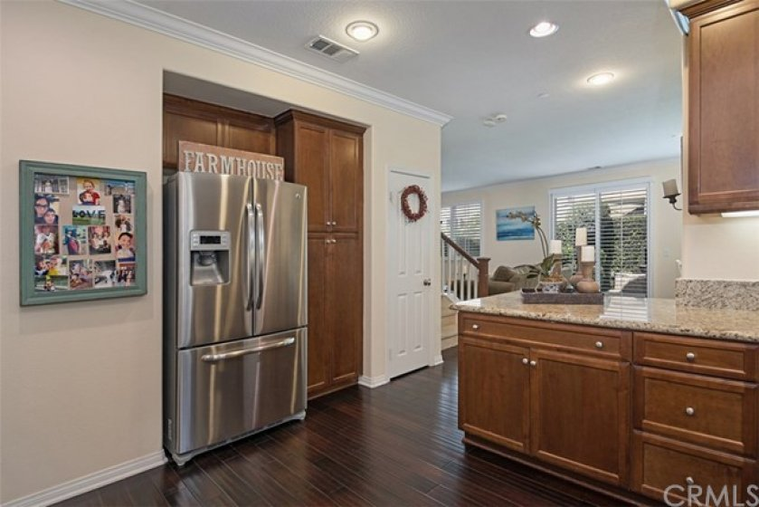 The large gourmet kitchen opens to the living and dining rooms