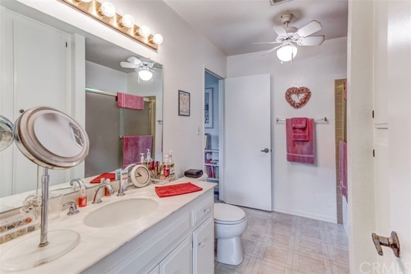 Large bathroom has access to both bedrooms.