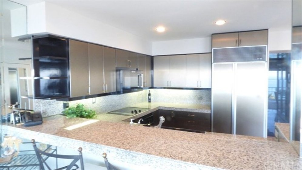 Modern European kitchen wit granite an modern appliances