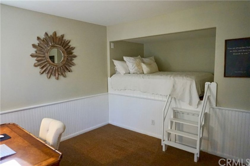 Bedroom #3 with wainscoting and built-in loft bed leaves lots of floor space and is a pleasant sight for the weary!  Plenty of room for the office desk as well.  This room also has built-in bookshelves and custom closet built-ins.
