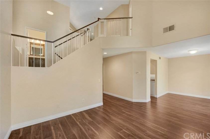 Move-in condition with fresh paint, wood laminate flooring, and custom baseboards