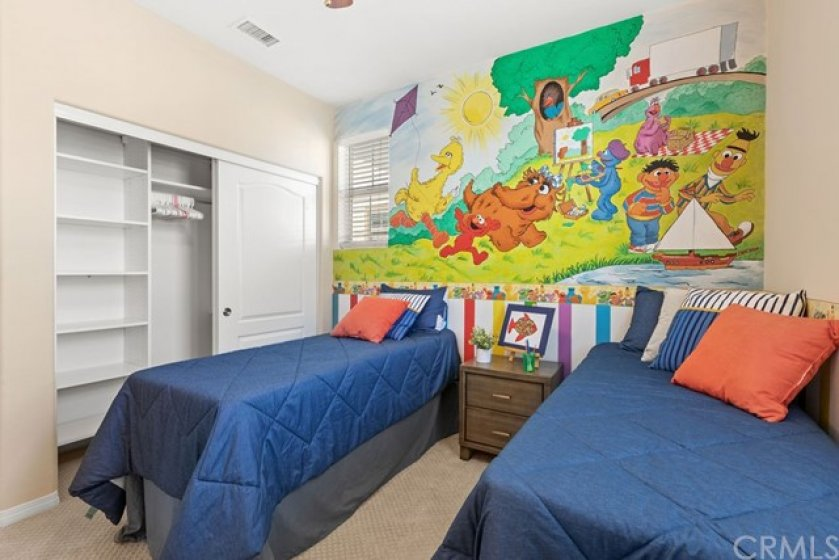 The third bedroom features a bright and cheery wall mural and custom paint and private en-suite bathroom.