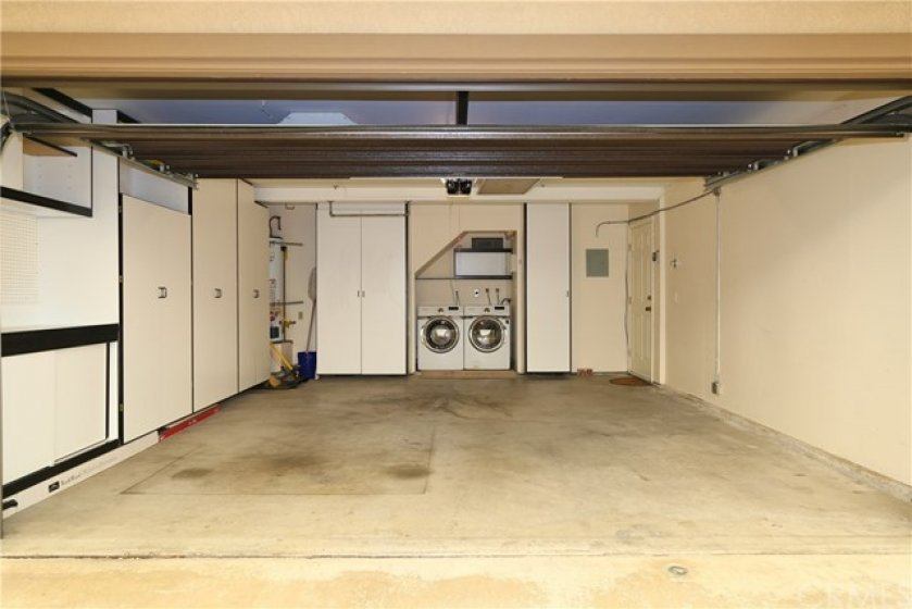 2 car garage with direct access to the house has a new garage door, new automatic garage door opener, upgraded storage cabinets, an area to do your laundry, plus the washer and dryer come with the house!