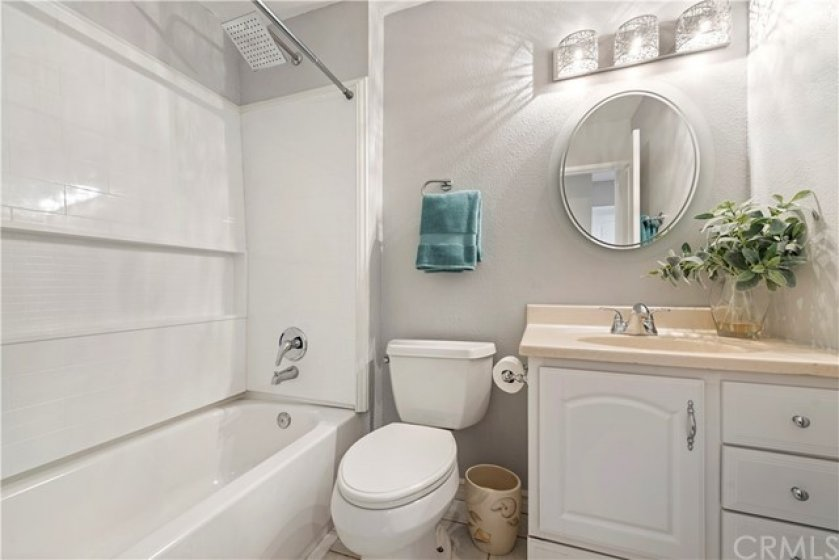 Hallway bathroom has been nicely upgraded and comes complete with tub/shower combo.