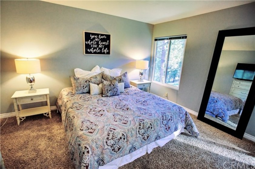 Two Master bedrooms with ensuite bathrooms.  This is the larger one with relaxing views from windows.