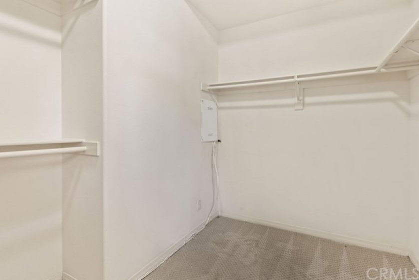 The large primary bedroom walk-in closet provides ample storage.