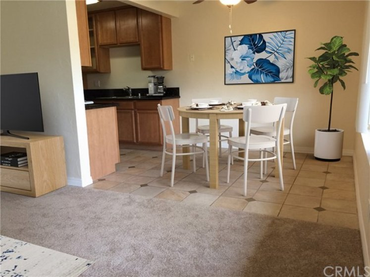 Dining room & kitchen have been virtually staged