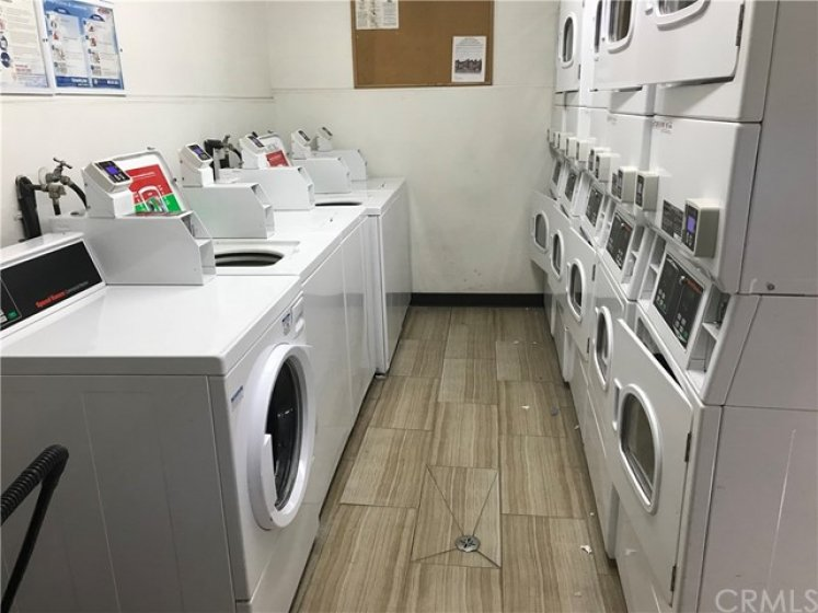 Newly Refurbished Community Laundry Area. Use your credit or debit cards and the app will let you know on your phone when your laundry is done!!