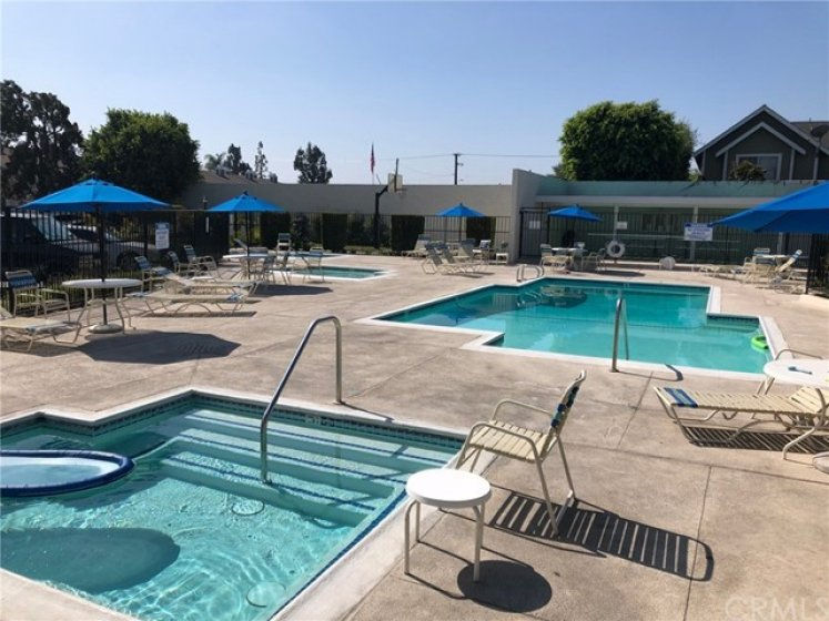 Plenty of water with a pool, 2 jacuzzi's, a baby pool and lots of seating. Also has an outdoor shower, basketball court and gated BBQ area.