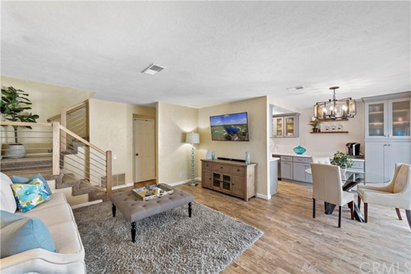 Step into your dream home!  Upgraded tile flooring throughout. Custom stair rail. Open concept living.