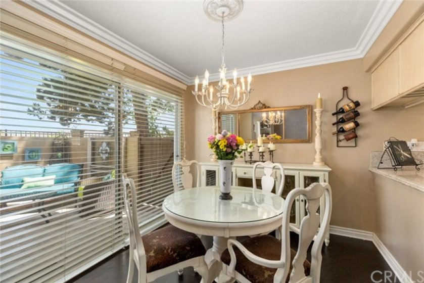 Dining room is separate and overlooks enclosed backyard- Crown molding and raised baseboards- Window blinds can be drawn for privacy