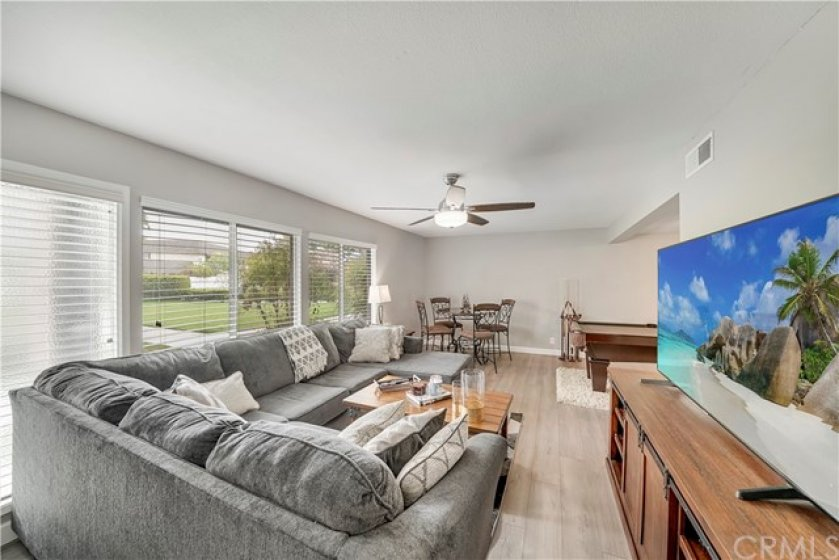 Updated, light, bright and modern! Stylish laminate flooring, neutral gray paint, smooth ceilings, spacious layout. This home overlooks a greenbelt so it has a great eastern exposure and doesn't face directly into another home - enjoy the view!