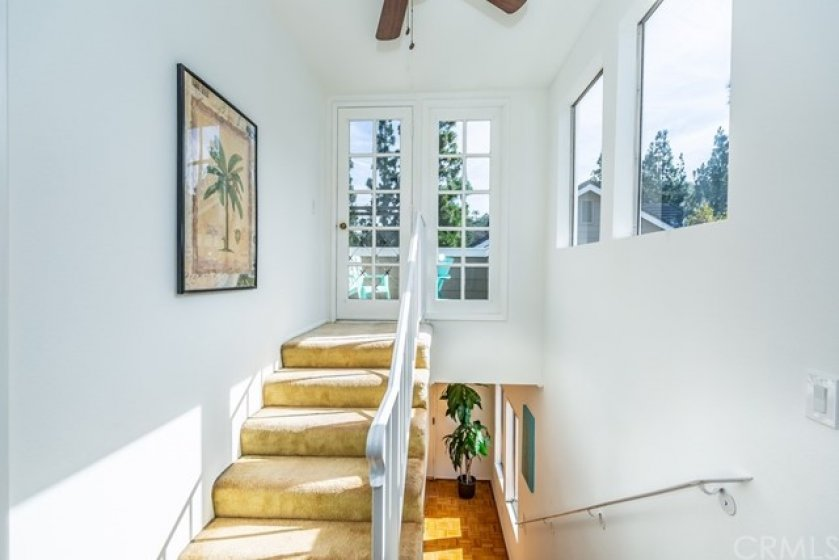 Another angle of the stairway which has lots of great natural lighting.
