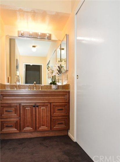 The 2nd bedroom's attached bath has upgraded vanity with quartz countertop, wide double door closet