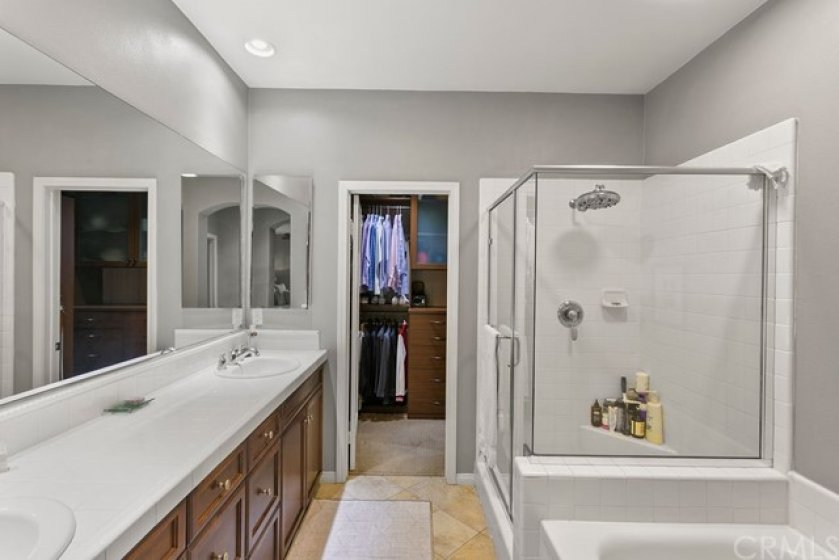 Spa like bathroom with soaking tub, dual sinks and separate shower.