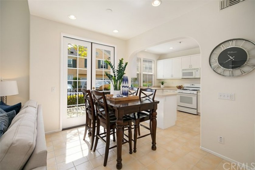 Separate dining room with French doors that lead to the side patio area.