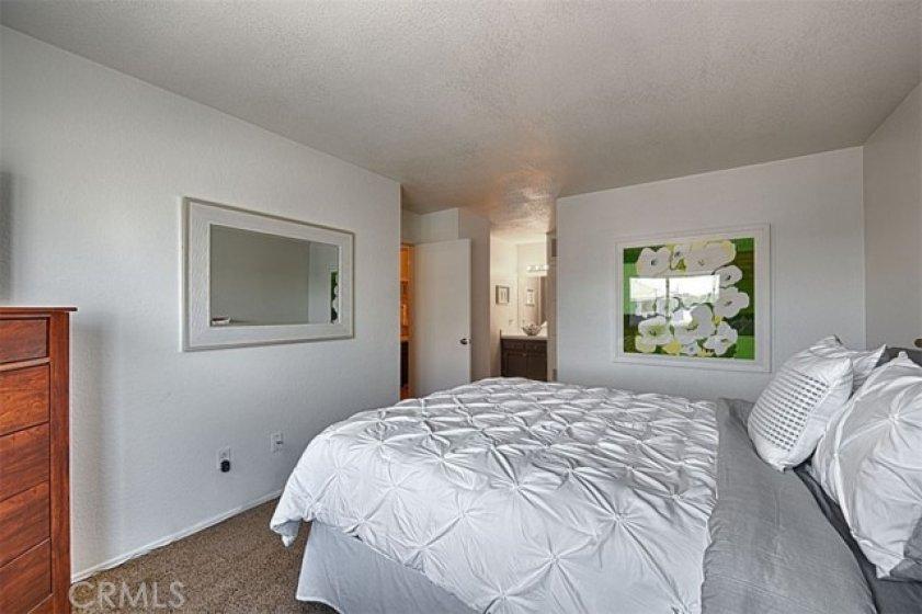 Master bedroom looking toward the vanity area and door to the bath.