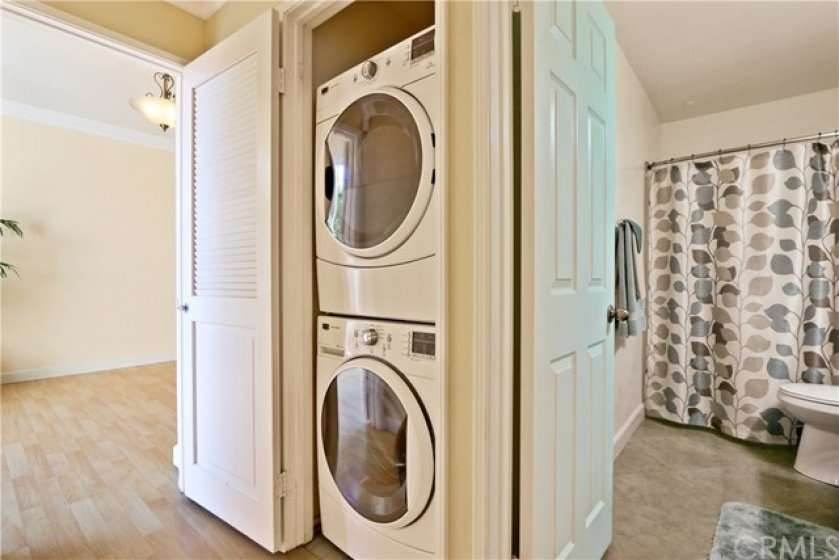 Inside laundry with stack-able washer and dryer, conveniently located in the hall closet.