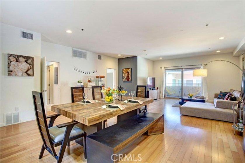 Huge open floor plan with beautiful hardwood floors, recessed lights.