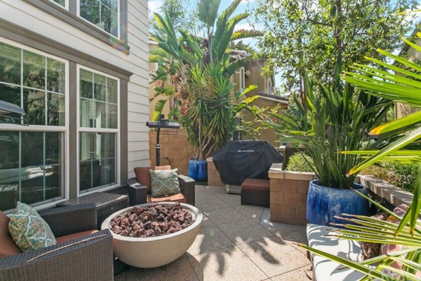 Another view showing the fire pit and beautiful potted plants.