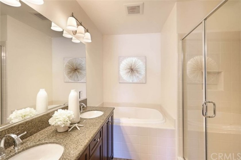 Sophisticated and well lighted bathroom to pamper you day in and day out. Oversized soaking tub is waiting for you after a long day at work!