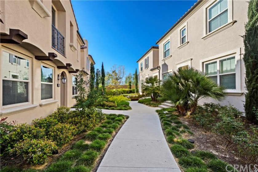 Well maintained walkway to your new home.
