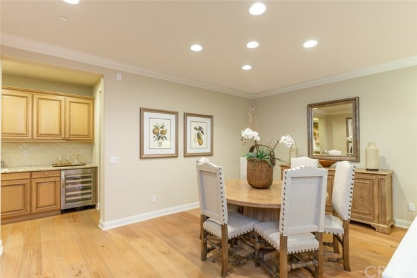 Elegant formal dining room with recessed lighting and crown molding accents.