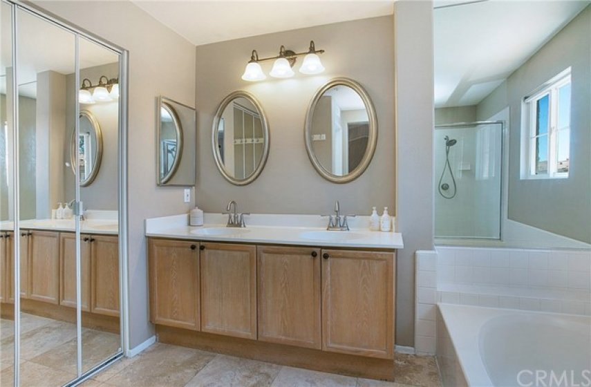 Master bath with dual vanities.