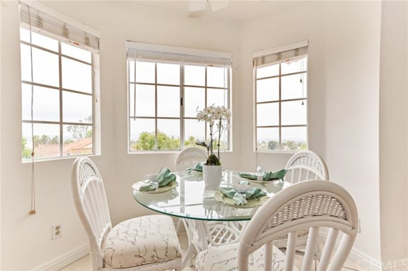 The dining nook in the kitchen is surrounded by windows  allowing you the same breath taking views as the living room.