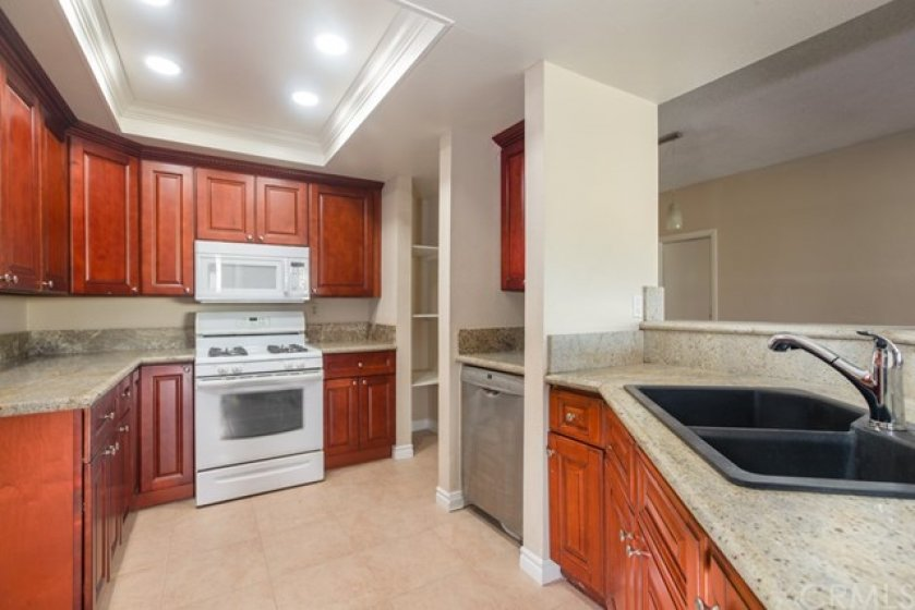 The Kitchen with Appliances and Granite Countertops.