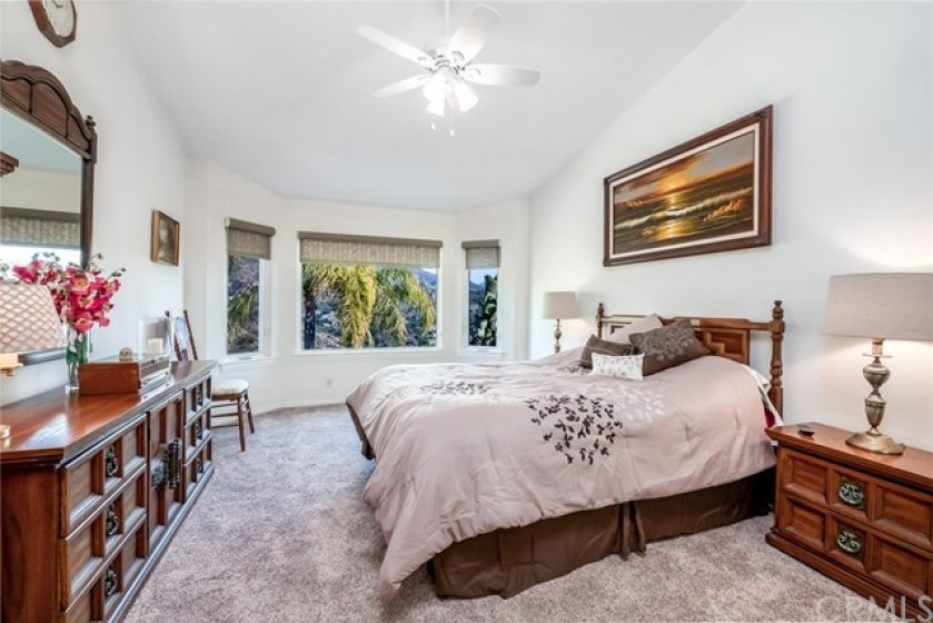 MASTER BEDROOM BRINGING THE AMAZING VIEWS IN...