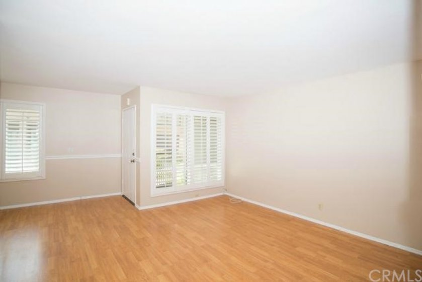 Large windows with plantation shutters overlook stream and fountains!