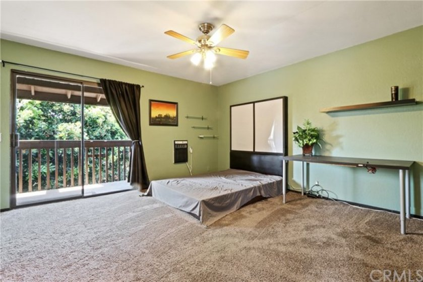 Both bedrooms have ceiling fans.  The master bedroom has a wall a/c unit.