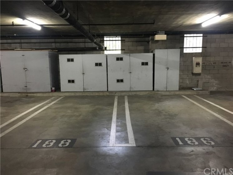 two of the Three assigned parking spots with storage
