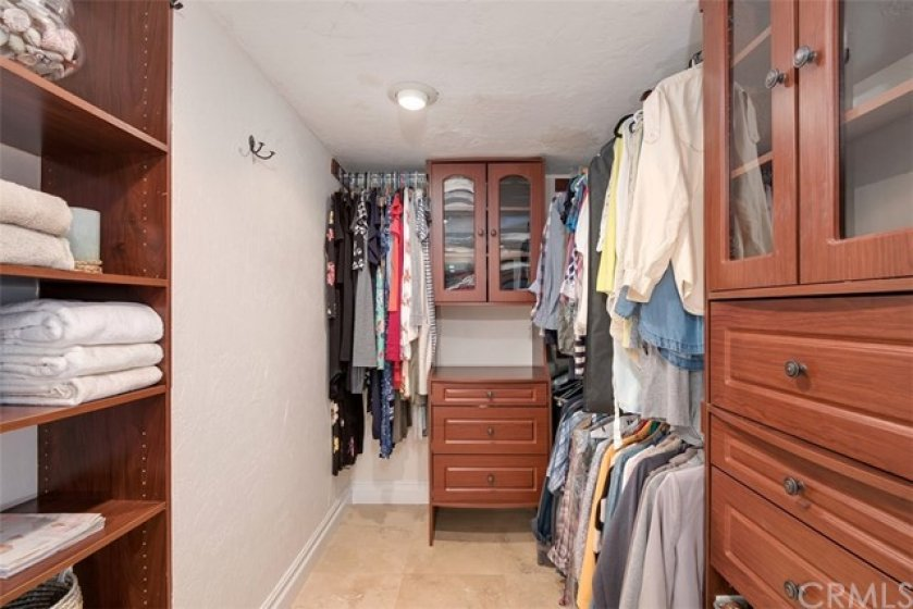 Beautiful walk in closet with custom shelves.