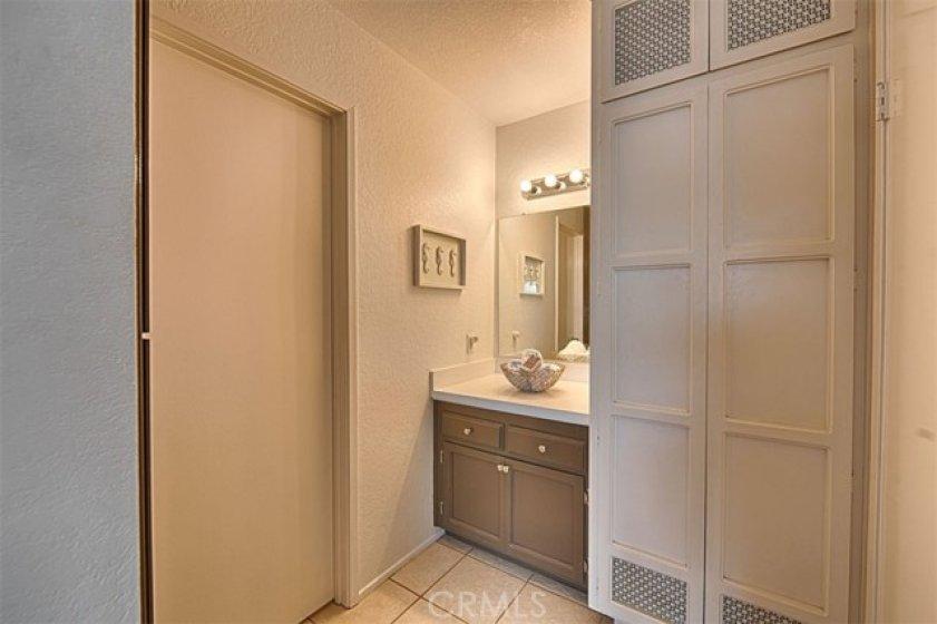 Vanity area in the master bedroom, door to the left is the bath.