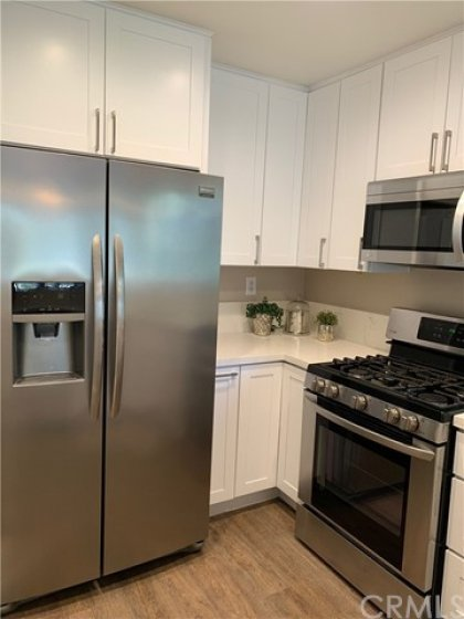 Stainless steel appliances. Lazy Susan in corner.