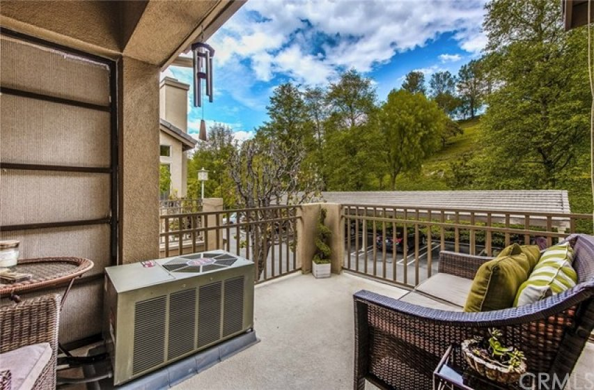 Enjoy morning coffee or evening snacks from your private patio with views of the surrounding hills!