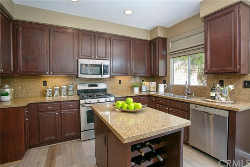 Kitchen with island and Bosch dishwasher and stainless appliances