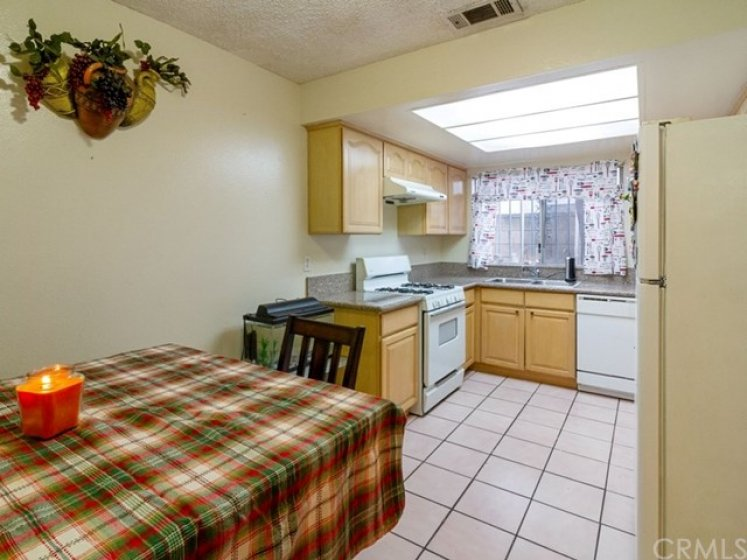 Kitchen has lots of cabinet space and plenty of room for your dining table.