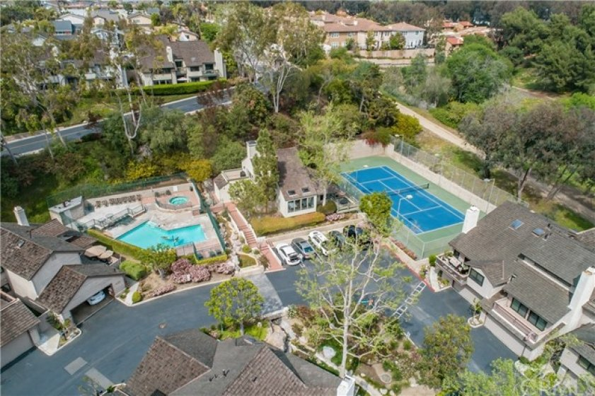The Clubhouse is Between the Pool and the Tennis Courts