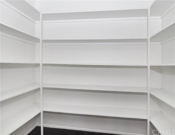 Huge linen/storage closet with built in shelving at 2nd level landing, adjacent to the bedrooms