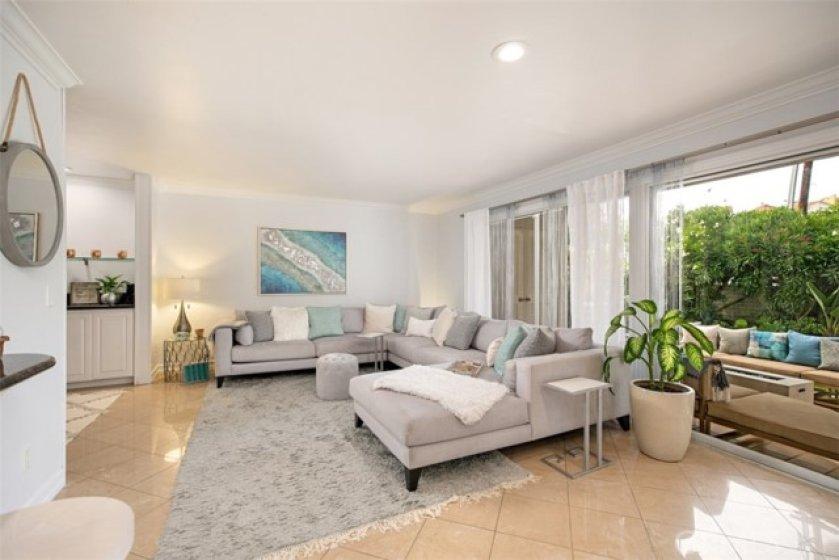 Open floor plan living room, den, and back yard patio