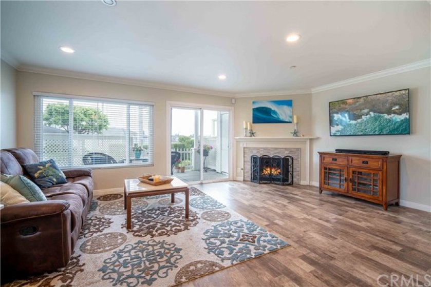 Large living room leading to private patio