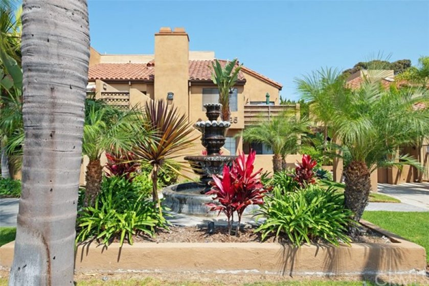 The lovely Fountain in the common area is surrounded by beautiful landscaping