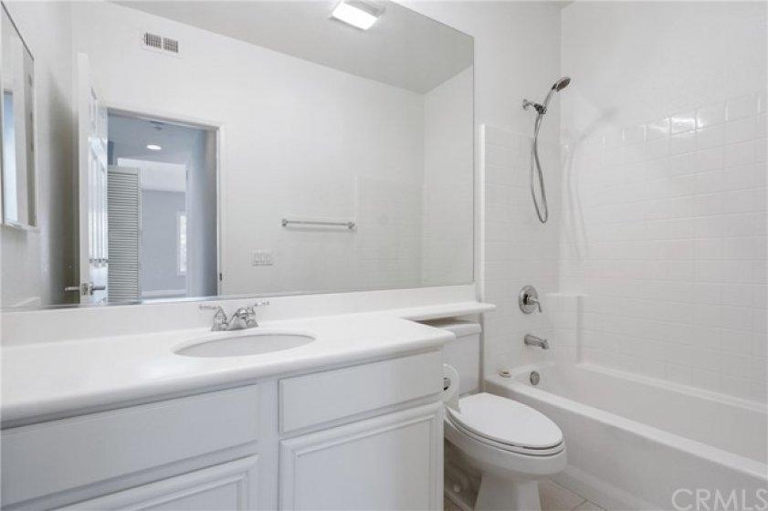 Main level Hallway bath with a tub