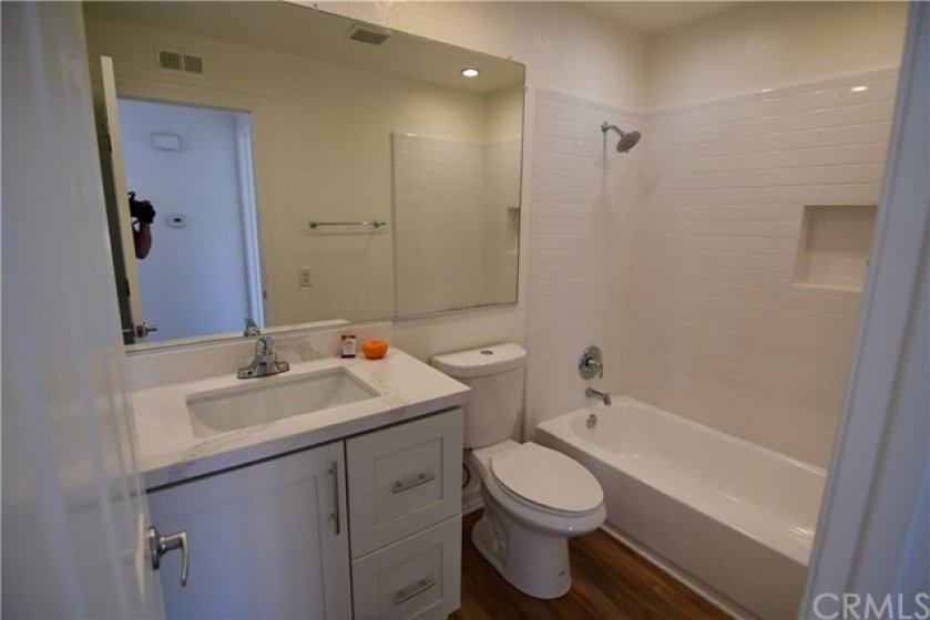 Bathroom has been completely remodeled. New vanity/sink/counter/faucet. New tile surround on tub/showwer. Newly refinished tub. New toilet. New laminate flooring plus recessed lighting.