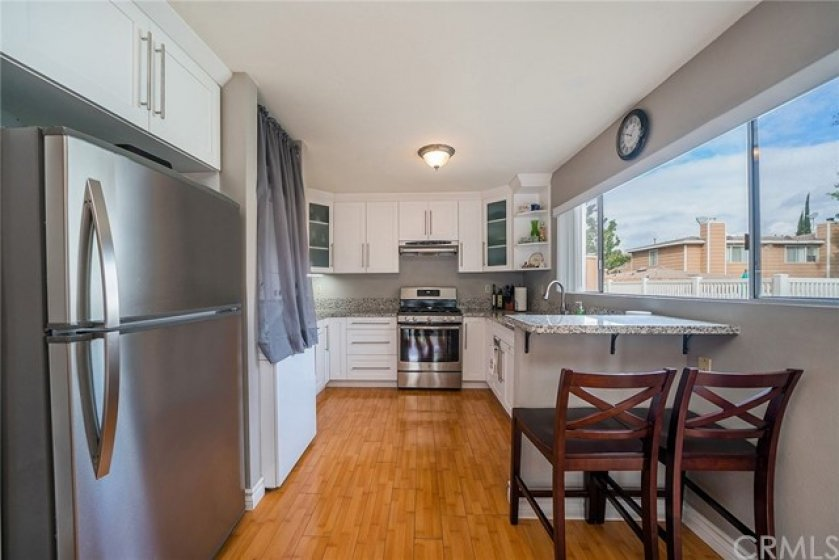 Great sample of a kitchen with a great floor plan.