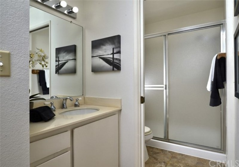 The master bath has a separate vanity area and a privacy door to the commode and walk-in shower.