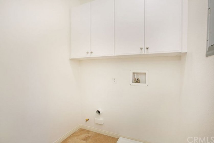 Indoor laundry room off the kitchen.